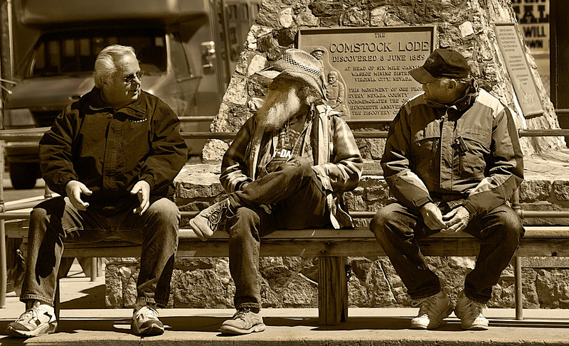 Shooting the Breeze<br /> <br /> Three tour operators waiting for the next load of tourists.