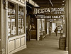 """Delta Saloon<br /> <br /> Located at the back of the Delta Saloon, the table is a Faro (the popular gambling game of the day) accoutrement with a macabre history. Supposedly, Black Jake (former owner of the ol' Delta) shot himself dead at the table back in the 1800s after losing a life savings one evening. Subsequent to Jake, two other owners purportedly killed themselves at this little """"Gambling Gateway to Hell,"""" for the same reason."""