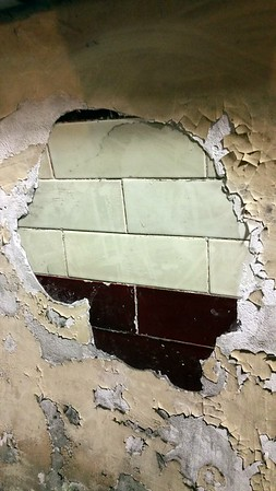 Original wall tiles were rendered over