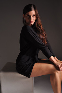Photoshootng with Kamilka Moravcova in Munich  Studio session with some Bond Girl motives  Side light with Model on square leather stool  Black evening dress and long earrings