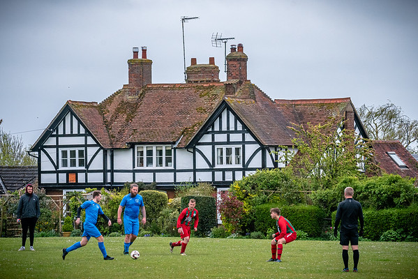Wingrave take on Quainton in front of one of the local houses that surround the Recreation Ground