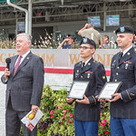 SPC Kyle Slape and SPC Daniel Badham receive awards from John Asher.