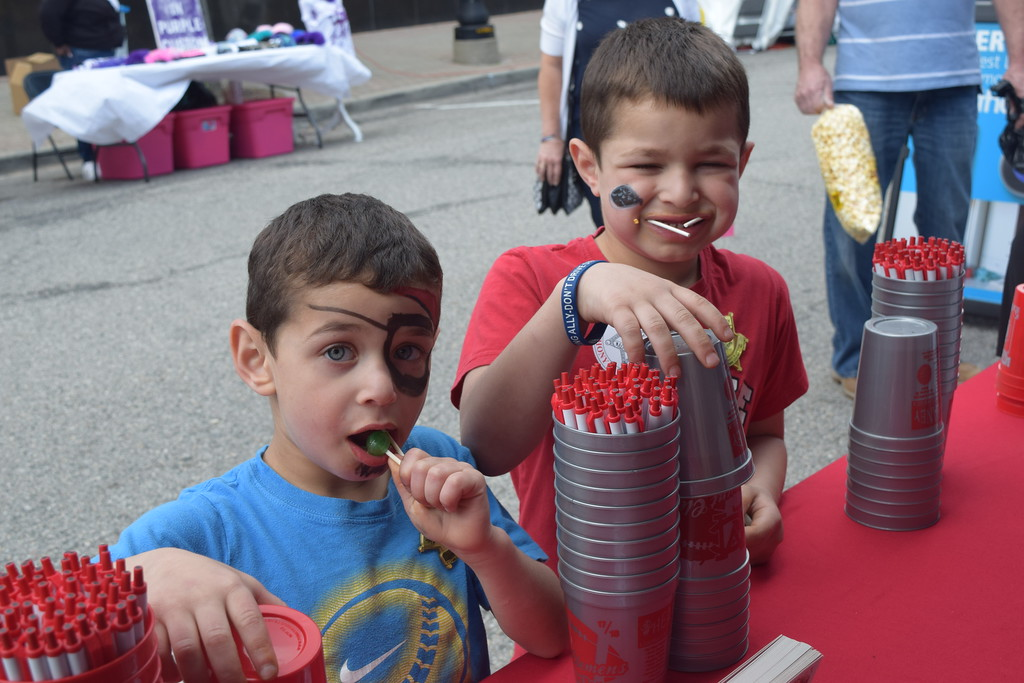 . Ayden, 5, and Alvani Hammos, 6, of Sterling Heights take advantage of the freebies at the downtown Mount Clemens Made in Michigan Show.