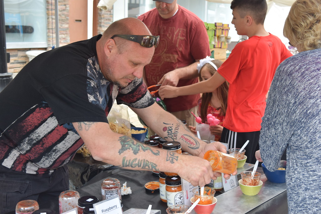 . Hank Zenla of Harrison Township fill up the samples of Jose Madrid Salsa.