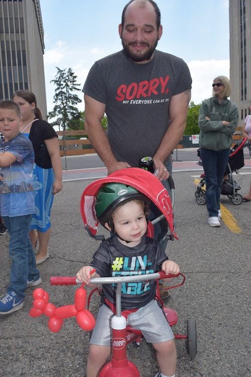 . Mason Palmer, 2, enjoys the parade of bicycles with his dad Henry Palmer of Mount Clemens.