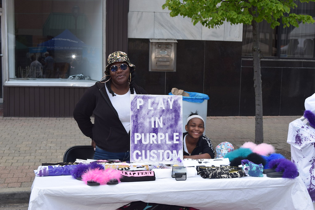. Elle and Takiyra Wilson of Mount Clemens with their Play in Purple display of custom designed T-shirts at the Made in Michigan Show in downtown Mount Clemens.