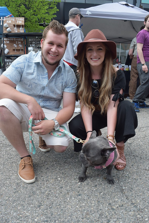 . Tyler Lewalski and Kalye Winowski of Harrison Township with their French Boxer dog Sadie Blue pause for a photo at the Made in Michigan Show in downtown Mount Clemens.