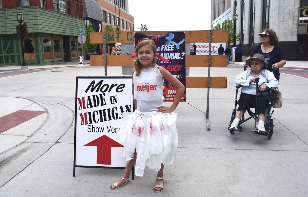 . Anne Stecker, 9, models the dress that she made out of plastic Meijer bags that she wore down the runway at the downtown Mount Clemens Made in Michigan Show.