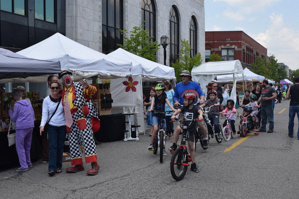 . Children in the bicycle parade pause to let Rosco get his picture taken.