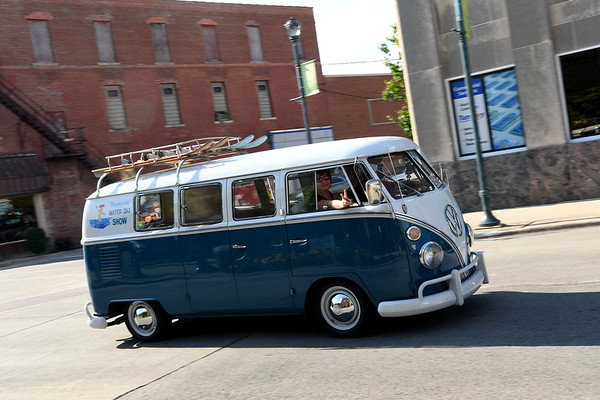 A VW Bus comes down Jefferson Avenue during the Mid America Motorworks' Fun Run Road Tour ending in downtown Effingham Friday afternoon as part of the 19th Annual Funfest for Air-Cooled Volkswagens.