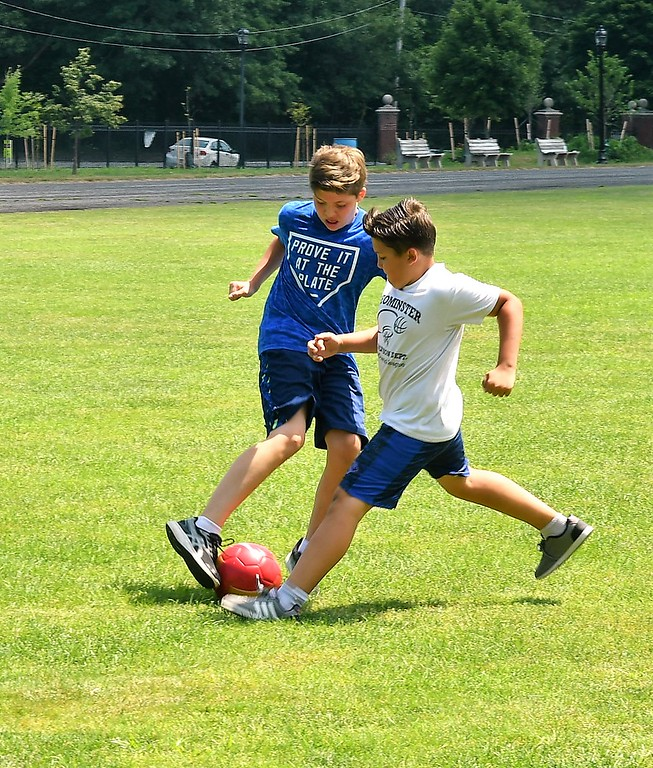 . Alex and Luis Gallego were working on their Soccer skills on Doyle Field on Friday. Sentinel & Enterprise / Jim Fay