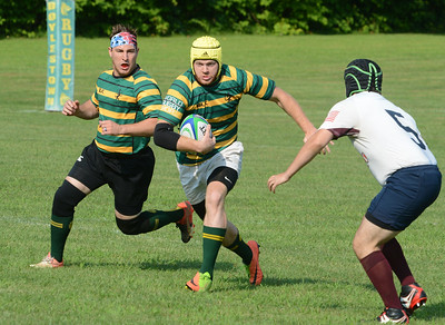 Mike Acker, center, takes off on good run against North Penn squad.