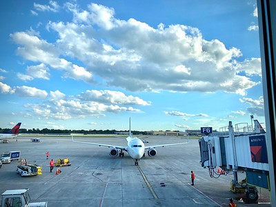 The test is negative, and the trip is on!  It seems like a great time to fly:  no middle seat passengers, more overhead space, orderly boarding and disembarking.  This is the plane that'll take me to Alaska from Minneapolis. (iPhone Photo)