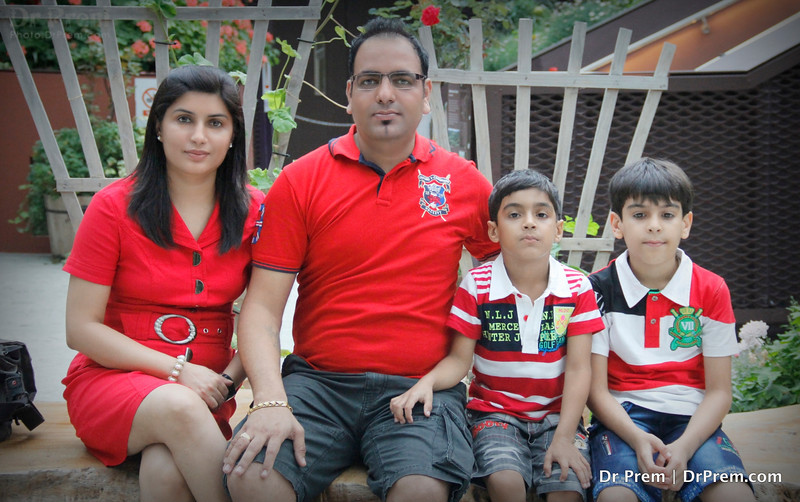 Dr Prem With Family--Dressed In Red