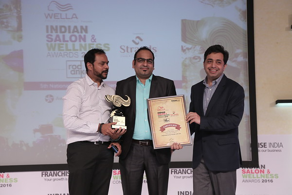 Dr Prem Recieving Award at Wellness India