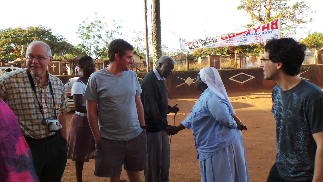 Professor Mike Scaperlanda , Luke Miles and Nick Spyrison from IBM with Sister Rosemary' at church during 7am morning mass greeting the parishioners.