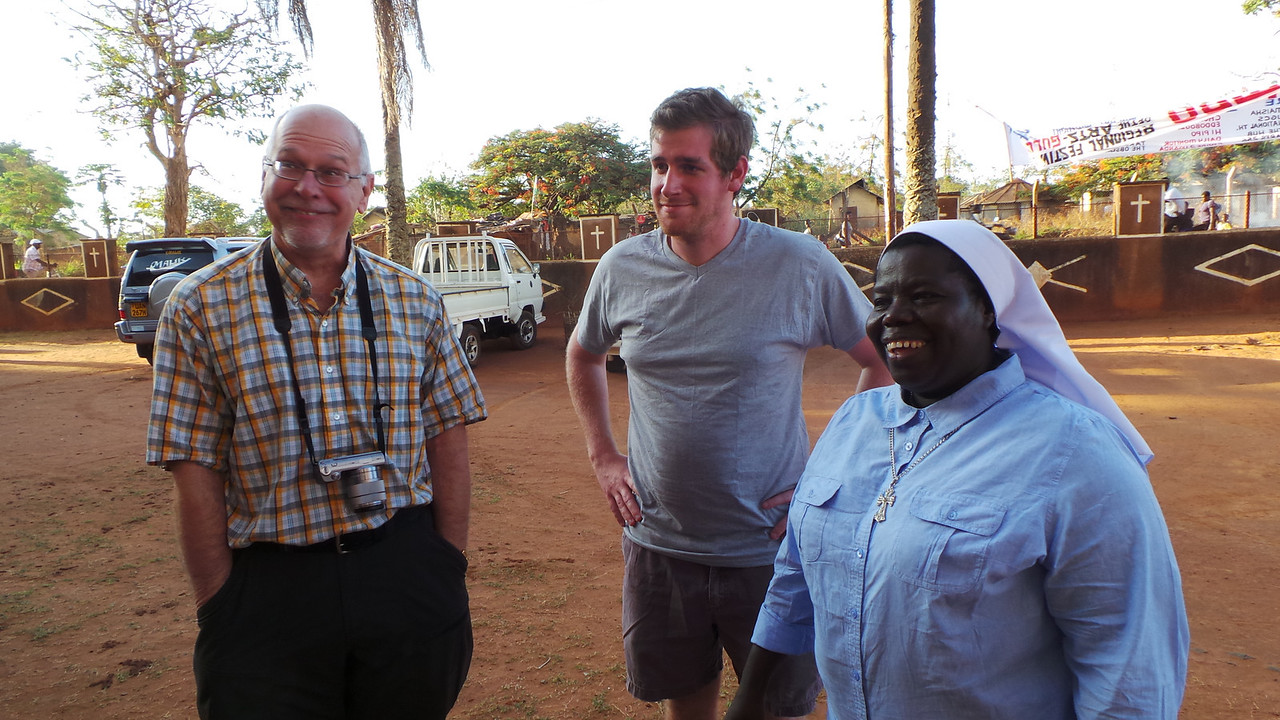 Professor Mike Scaperlanda  and  Luke Miles  with Sister Rosemary' at church during 7am morning mass greeting the parishioners.