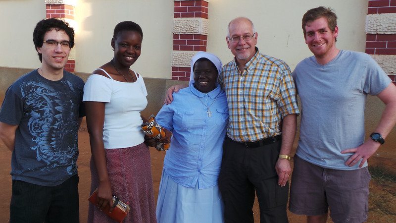 Nick Spyrison from IBM, one of Sister Rosemary's previous students, Sister Rosemary, Professor Mike Scaperlanda and Luke Miles at Sister Rosemary's church during 7am morning mass.