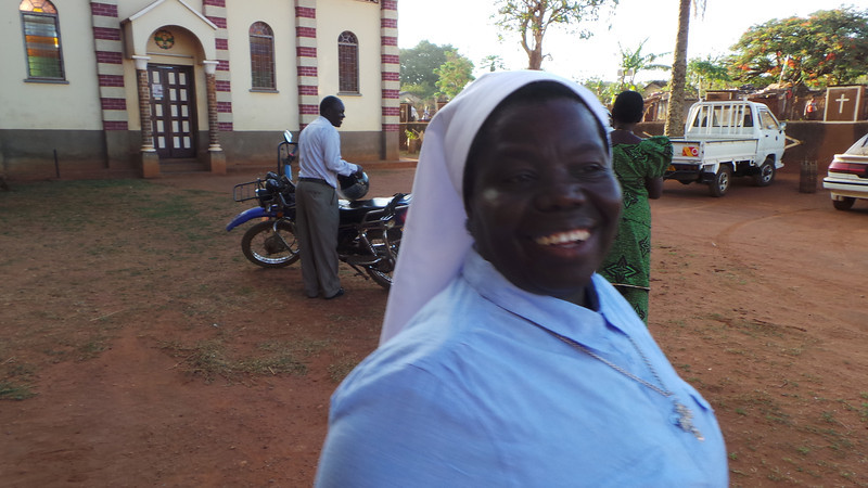 Sister Rosemary at morning mass with OU students and their professor.