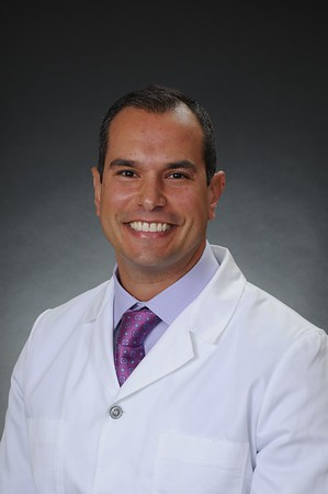 Dr Tsangaroulis