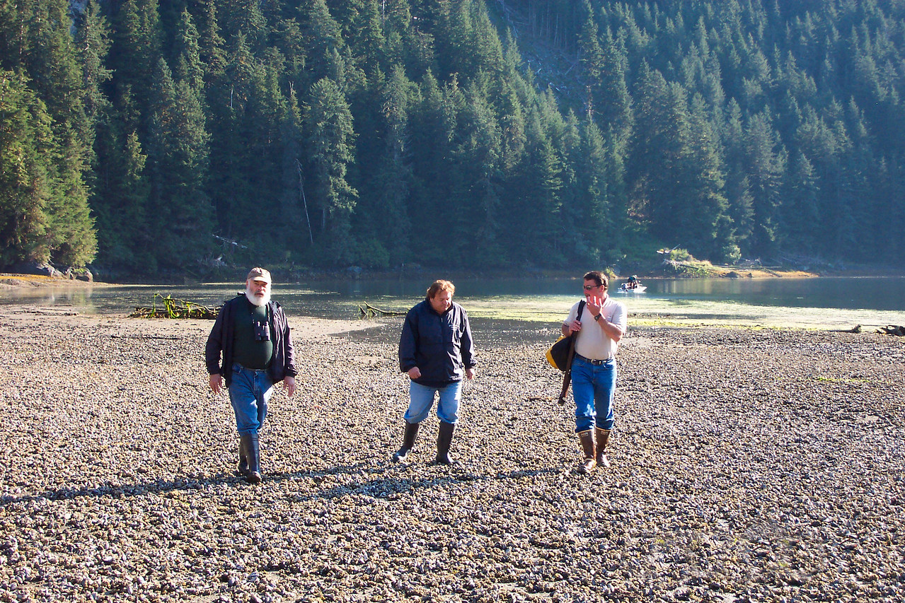 Walking on the water's edge. From right to left, this is John Pisto, Captain Dennis Rogers, and I on Baranof Island. The morning we cruised into the  island's harbor, we saw several adult grizzly bears feasting on salmon in this exact location.