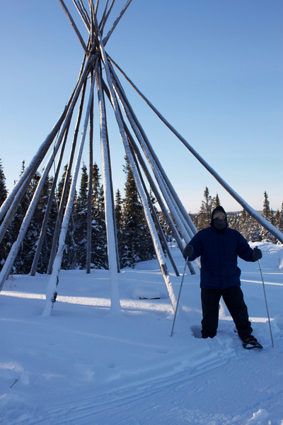 In the warmer summer months, this teepee is covered with canvas and habitable; but in the winter, it remains uncovered and solely serves as an interesting landmark in the stark landscape.