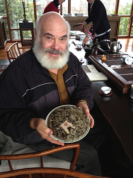 "I'm holding a cake of ""Moonlight White"" pu-erh tea. You'll find more about it in this article: <a href=""http://weil.ws/4JXZhU"">http://weil.ws/4JXZhU</a>."