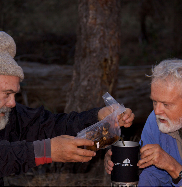 Making a meal with a friend. Pouring dried, reconstituted morel mushrooms into a backpacking-stove pot held by a friend of 30 years, Steven Rooke. Rooke has climbed Rincon Peak seven times, and served as the trip's guide.