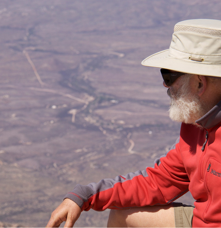 Admiring the view. In the clear desert air, the view goes on forever.