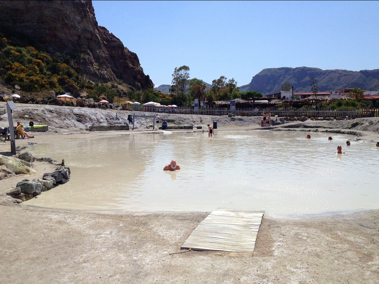 "Laghetto di Fanghi is a celebrated ""mud bath"" on the island of Vulcano near the coast. Bathers cover themselves in mud (reputed to have therapeutic powers) and then go into the spring-warmed sea to wash off. This was a great treat right after we hiked down from the live volcano.<br /> <br /> Vulcano is a great little island, but it smells like rotten eggs."