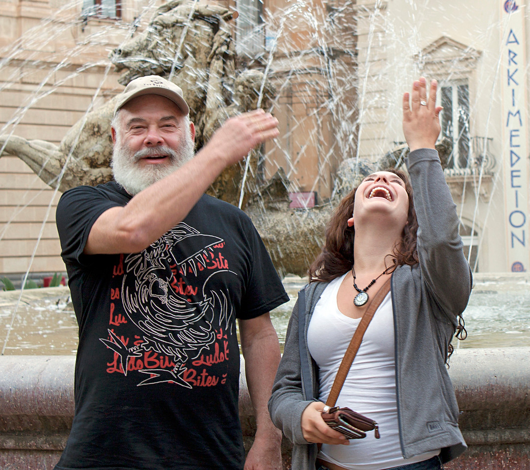 My daughter Diana and I tossing coins into the fountain dedicated to the Roman goddess Diana. According to Roman mythology, Diana was the goddess of the hunt, the moon, and birthing. Who wouldn't want to throw a coin into a fountain honoring a goddess that shares your - or your daughter's - name?