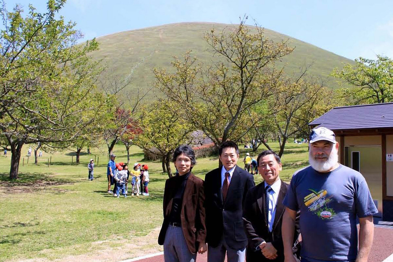 With Mt. Omura in the background, I am posing with MOA museum members Sakakibara-san, Kato-san and our driver.