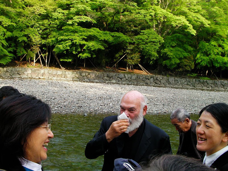 I am drying off after a purification ritual - I was washed with water from the Isuzu river, which runs inside the Ise Shrine. The woman on the right is Minobe-san, a Shinto priestess who guided me around the shrine on a previous visit.
