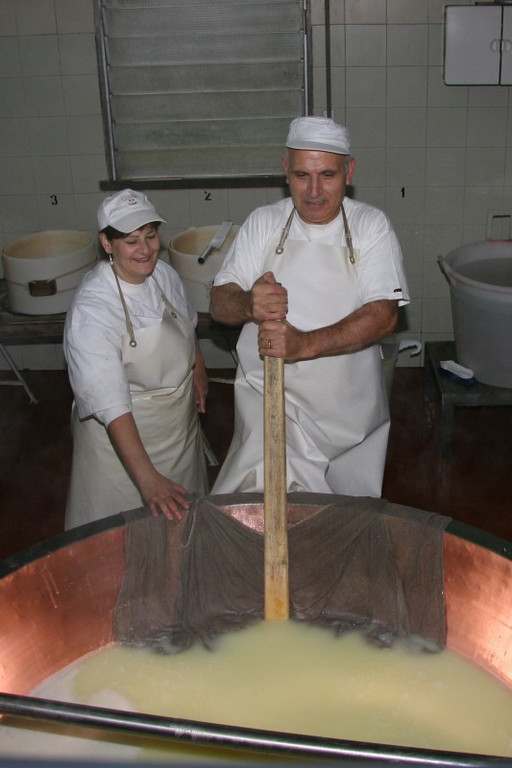 Cheesy couple! The cheesemakers have been husband and wife for 27 years. They are about to take the curdled milk from the bottom of the copper cauldron and wrap it in muslin.