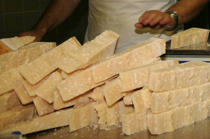 Ready for packing. Lucini Organics Parmigiano Reggiano is hand-cut into eight-ounce wedges.