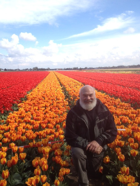 Enjoying the colorful rows of tulips which were as far as the eye could see.