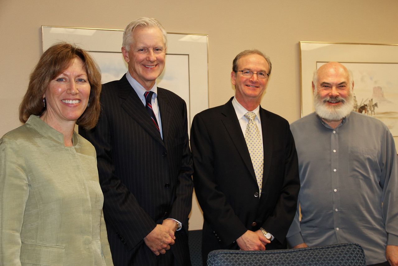 Dr. Victoria Maizes, executive director of the Arizona Center for Integrative Medicine (AzCIM); David Smith, Maricopa County manager; John Jackson, Adolf Coors Foundation's executive director; and Dr. Andrew Weil, founder and program director of AzCIM - after the agreement is approved.