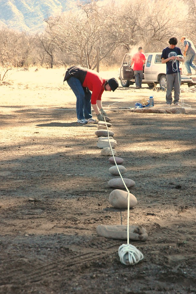 "The first row of ""marker"" stones takes shape: these first 12 stones mark the 12 concentric courses around the center stake."