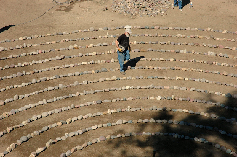 With the labyrinth largely done by early afternoon, Dr. Weil carried individual stones to fill the few remaining gaps.