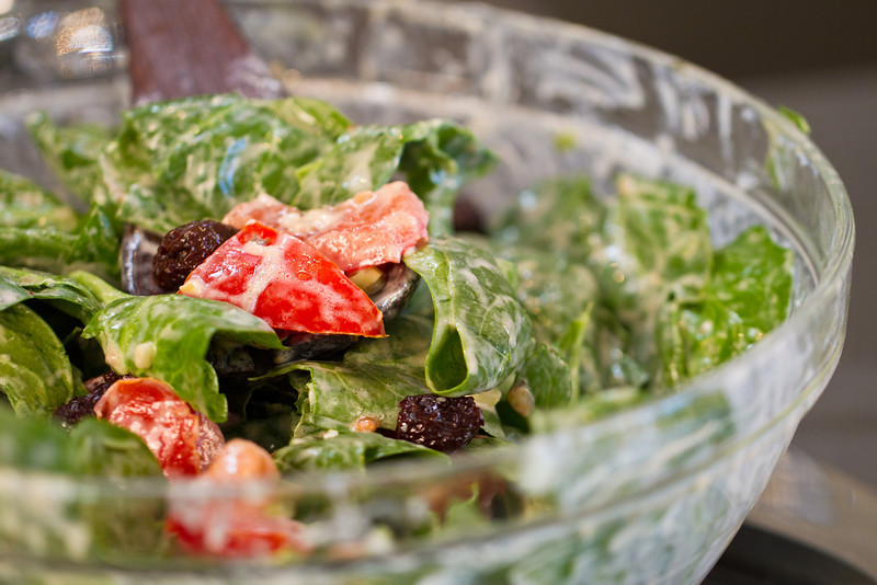 """Turkish Spinach Salad with Dried Black Olives. The creamy dressing is a simple mixture of yogurt, olive oil, garlic, thyme and black pepper. See me prepare <a href=""""http://www.drweil.com/drw/u/VDR00034/Home-Cooking-with-Dr-Weil-Turkish-Spinach-Salad.html""""> this salad</a>."""