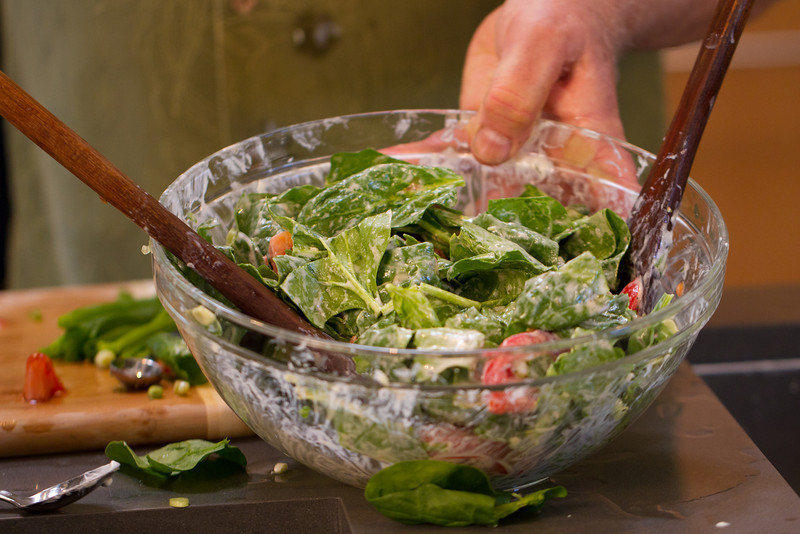 "Turkish Spinach Salad, tossed and ready to enjoy! Spinach, tomatoes, scallions and a luscious yogurt dressing. <a href=""http://www.drweil.com/drw/u/RCP00199/Turkish-Spinach-Salad.html""> Make it today!</a>"