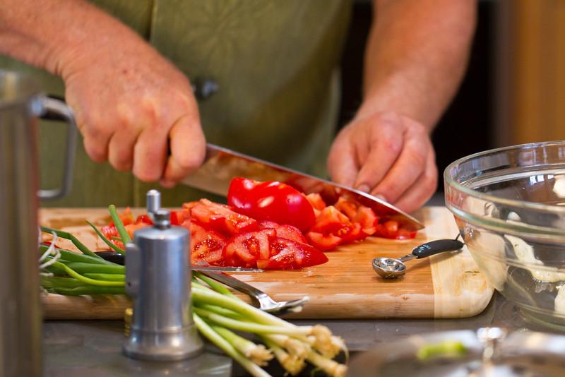 "Fresh, organic tomatoes, being chopped for my <a href=""http://www.drweil.com/drw/u/RCP00199/Turkish-Spinach-Salad.html"">Turkish Spinach Salad </a>."