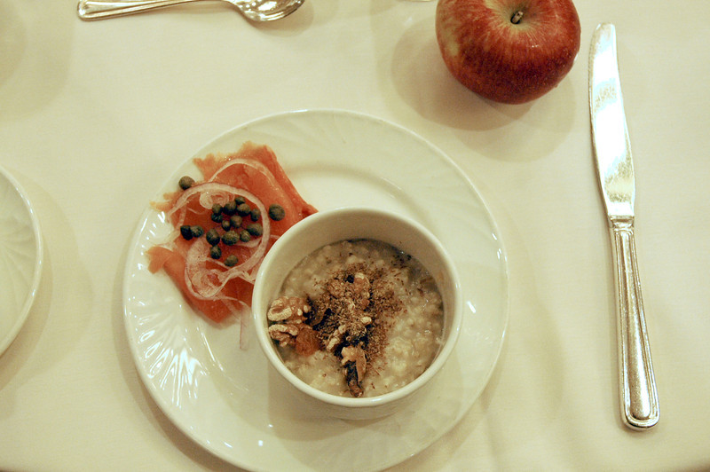 Breakfast of steel cut oats with walnuts and salmon