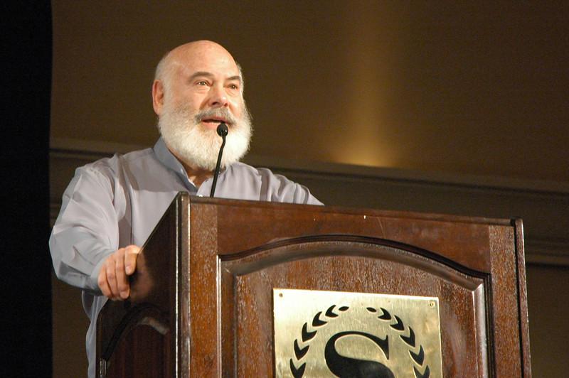 Speaking at the podium