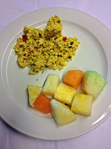 A tofu scramble with mixed fruit strikes the perfect balance between healthy protein and antioxidant-rich carbohydrates.