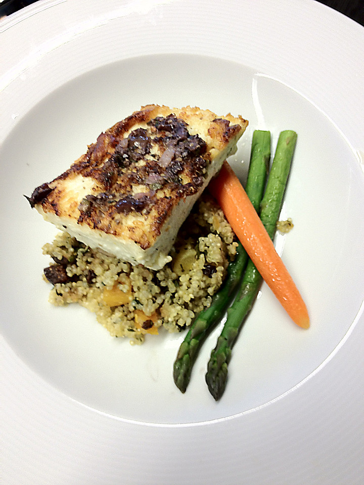 This main dish included lemon-grilled Alaskan halibut topped with an olive mint vinaigrette on a bed of quinoa with fresh herbs, nuts and vegetables.