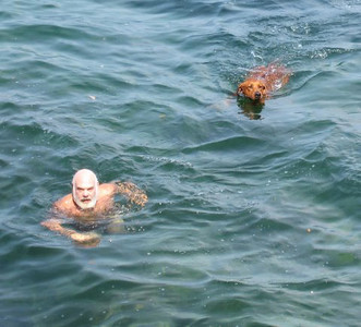 Ajax and I enjoying a cool summer swim in the Pacific ocean in front of my house on Cortes Island, B.C.