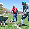 Working on the softball field at Jocker's Lounge, getting it ready for the season is Ed Morgan, Manager and worker Eric Hunt, the field is used alot during the summer with 2 games a night 5 nights a week and on weekends one pitch touraments for charity. SUN/ David H. Brow