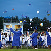 Students toss their hats into the air after receiving their diplomas at Dracut High School's graduation Friday. Lowell Sun/Chris Lisinski