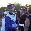 Staff hand out diplomas at Dracut High School's commencement Friday. Lowell Sun/Chris Lisinski